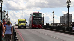 London ambulance overtaking traffic on busy bridge London UK Footage
