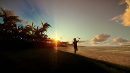 Little boy with airplane toy on a tropical beach at sunset Animation