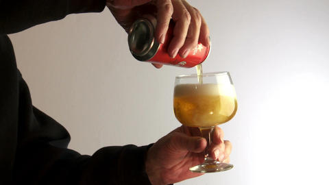 male hands pour beer from can Footage
