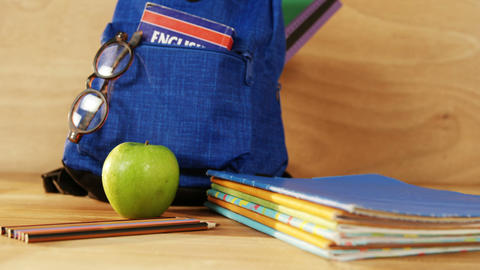 Close-up of school bag with books and spectacles Live Action
