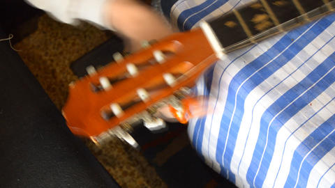 Unwinding String On Spanish Guitar Very Fast Live Action