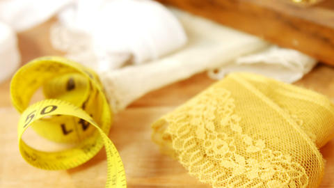 Close-up of measuring tape with lace cloth Live Action