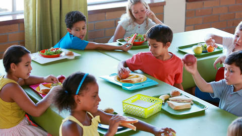 Kids having meal in cafeteria Footage