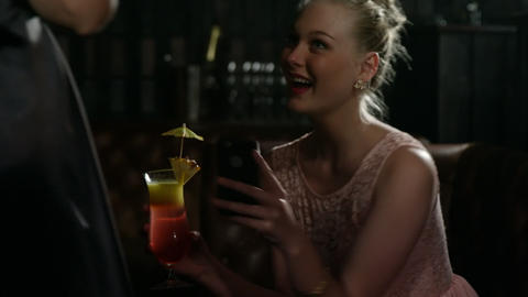 Female friends interacting with each other while having cocktail Footage