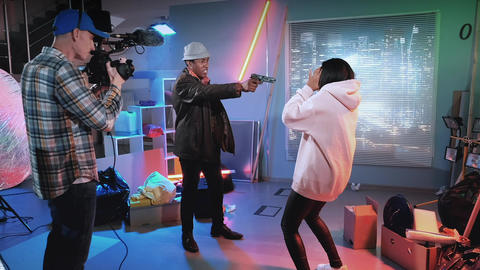 Backstage of mystery film shooting: african criminal trying to shoot african Live Action