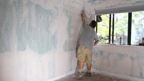 Plasterboard renovation plastered putting plaster on wall Live Action