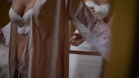 A young girl is wearing a bathrobe. White underwear for the girl. A woman's Live Action