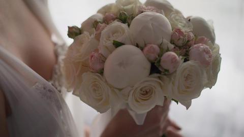 Beautiful wedding bouquet in hands of the bride. Beautiful bouquet in the hands Live Action