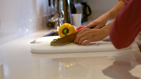 Woman cutting vegetables on chopping board Live Action