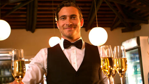 Male waiter serving a glass of champagne Footage