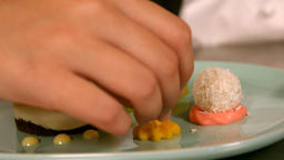 Hand of a chef preparing dessert food Live Action