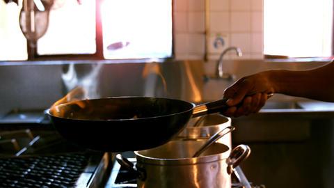 Hand of chef preparing food Footage