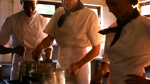 Group of chefs holding their dishes Footage