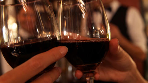 Hands of couple toasting glasses of wine Footage