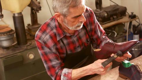 Cobbler hammering on a shoe Live Action