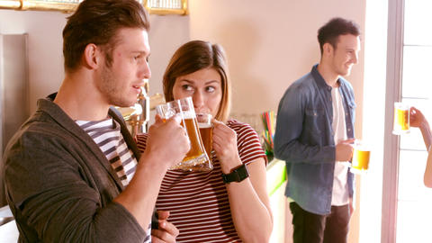 Couple interacting while having a glass of beer Live Action