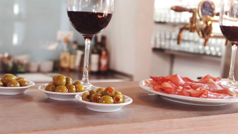 Glass of red wine and snacks on bar counter Stock Video Footage