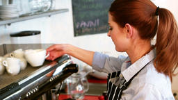 Waitress working at counter Footage