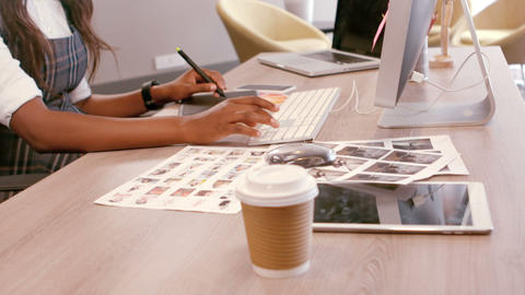 Female graphic designer using graphic tablet Live-Action