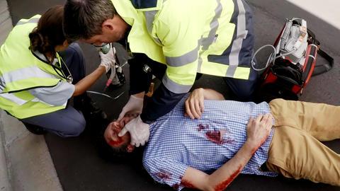 Paramedic using an external defibrillator during cardiopulmonary resuscitation Footage