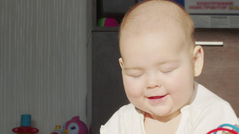 Close up of lovely little baby girl smile. Portrait of infant smile Live Action