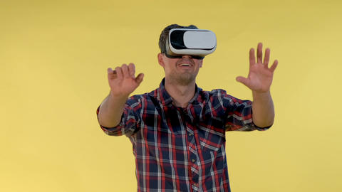 Cheerful young man are amazed with using VR goggles Live Action