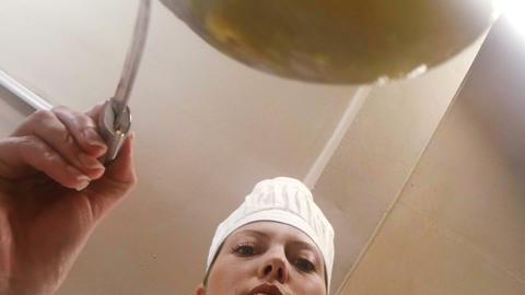 Female chef preparing food Footage
