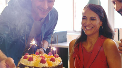 Colleagues celebrating birthday of female business executive Live Action