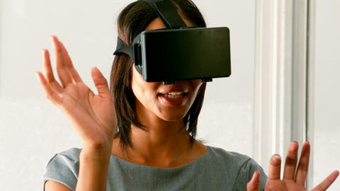 Female business executive using virtual glasses Footage