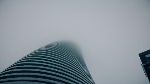 Glass skyscraper in the fog Footage