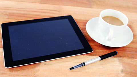 Digital tablet with pen and cup of coffee Footage