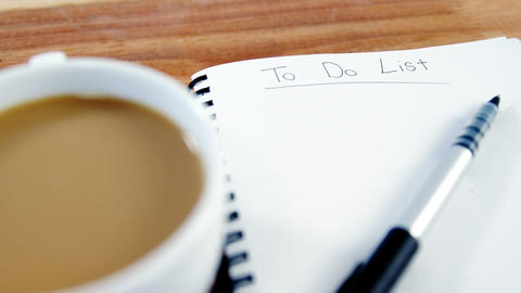 Cup of coffee with diary and pen Footage