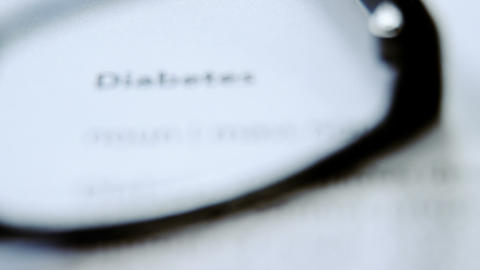 Diabetes text on paper through spectacles Live Action
