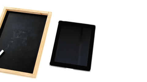 Digital tablet and slate on white background Live Action
