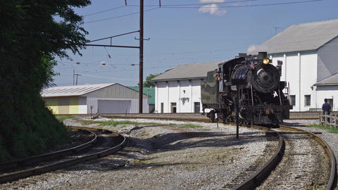 Antique Steam Locomotive Traveling Around a Bend on a Spur Live Action