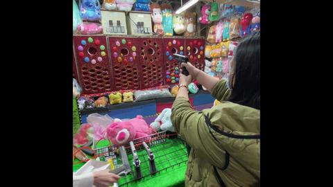 night market game: ball bullet gun Live Action