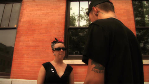 (1109) Young urban couple with piercings having a discussion Stock Video Footage