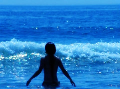 Playing in ocean waves Stock Video Footage