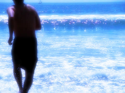 Man running through ocean waves Stock Video Footage
