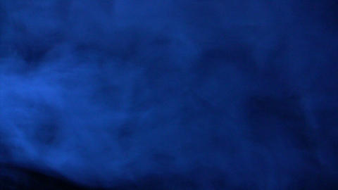 Pure blue smoke in dark environment Stock Video Footage
