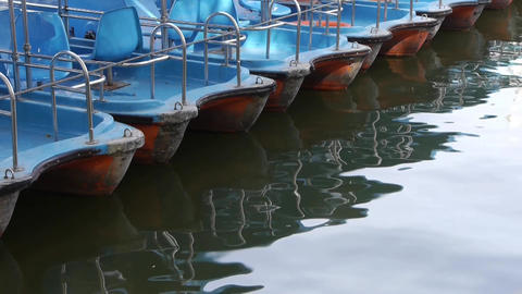 a row of boats on lake,reflection on the water Footage