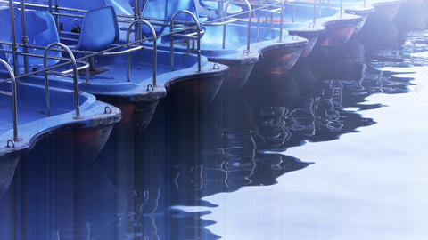 a row of boats on lake,reflection on the water Stock Video Footage