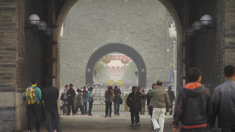 tourist pass ancient city gate tower & arch in... Stock Video Footage
