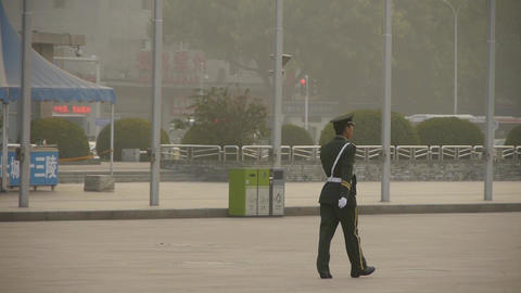china police patrol pass ancient city gate tower & Stock Video Footage