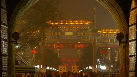night scene ancient city gate tower & arch in beijing china,lively crowd Footage