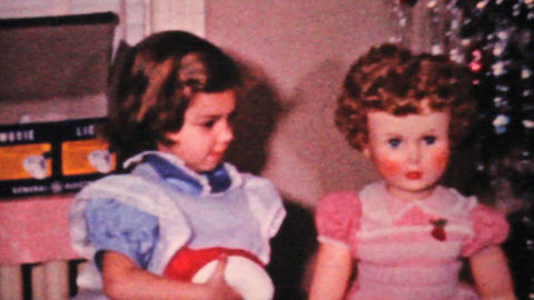 Girl Kissing Her Doll At Christmas 1964 Vintage 8mm film Stock Video Footage