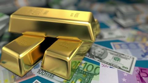 gold bars and money on a table Stock Video Footage