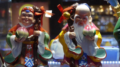 china myth character pottery artwork in store cupboard Stock Video Footage