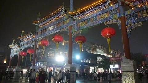 crowd walk on Chinatown,China Beijing night market,memorial arch & lantern Footage