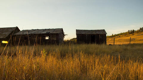 Sunset over old broken wooden houses Stock Video Footage